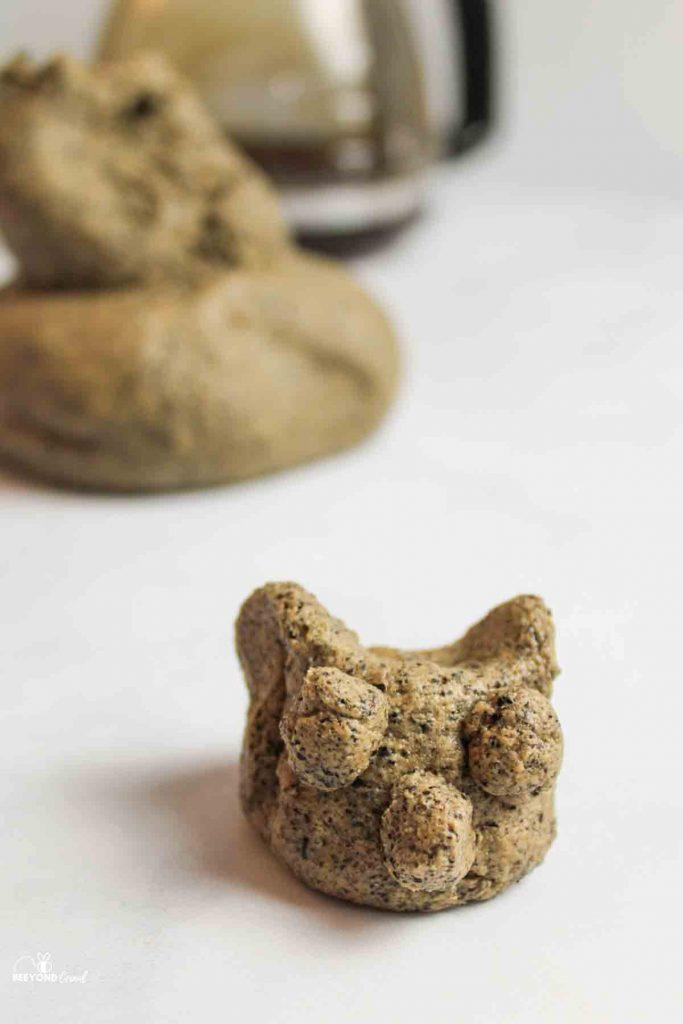 coffee playdough shaped into cat head