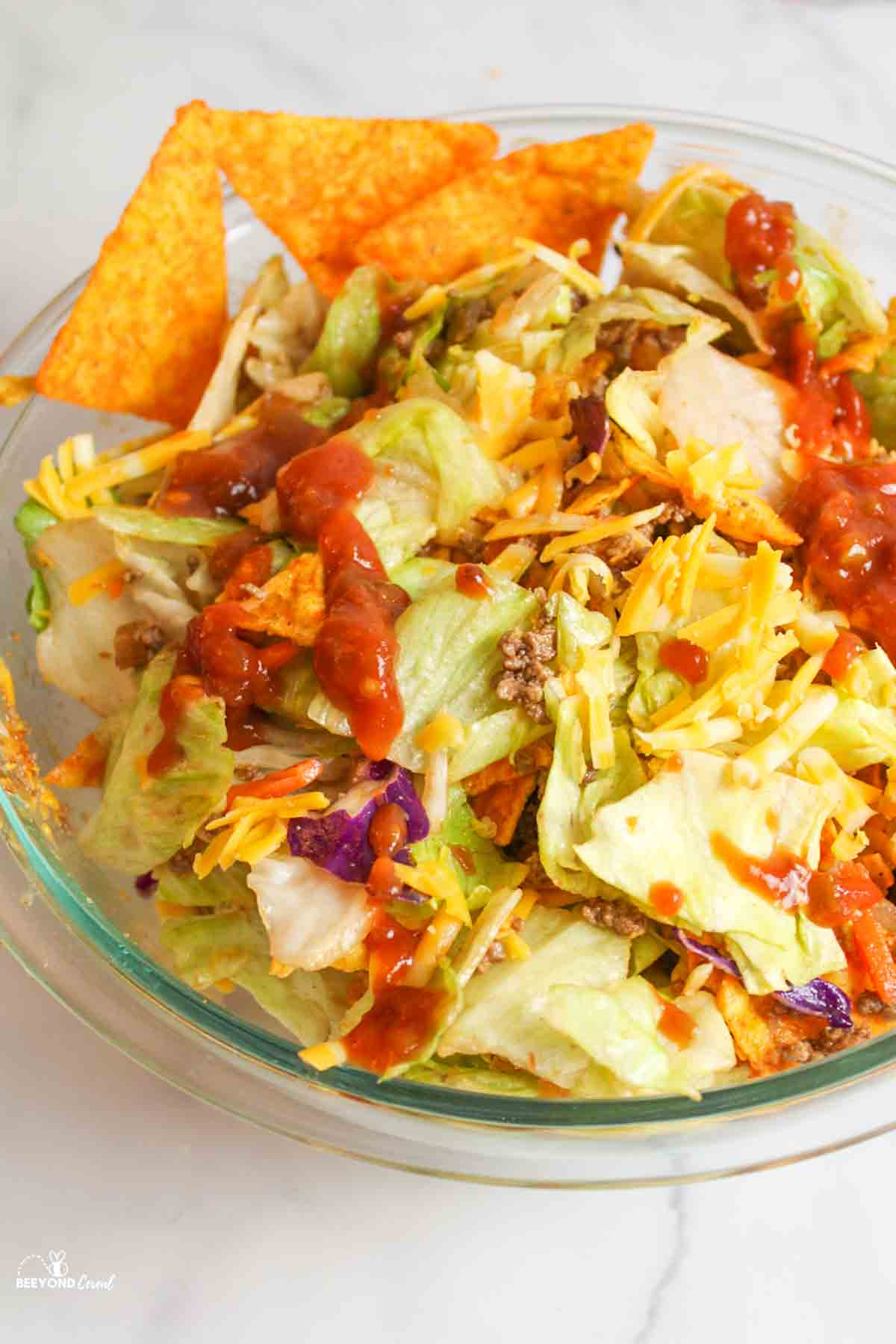 a serving bowl filled with dorito salad