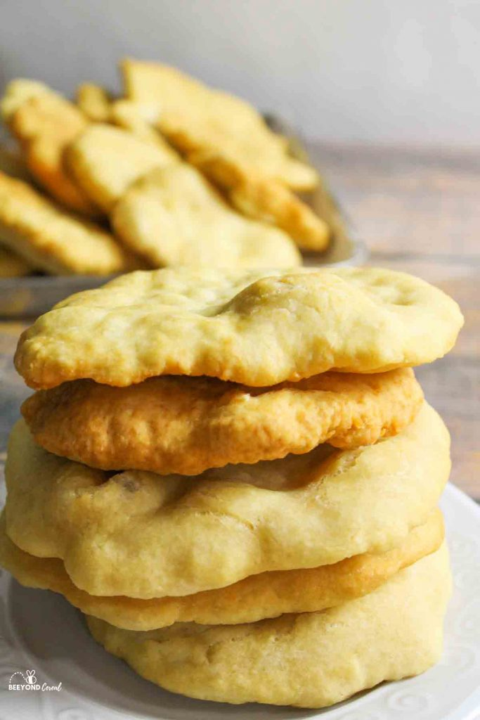 stacked frybread on a white plate