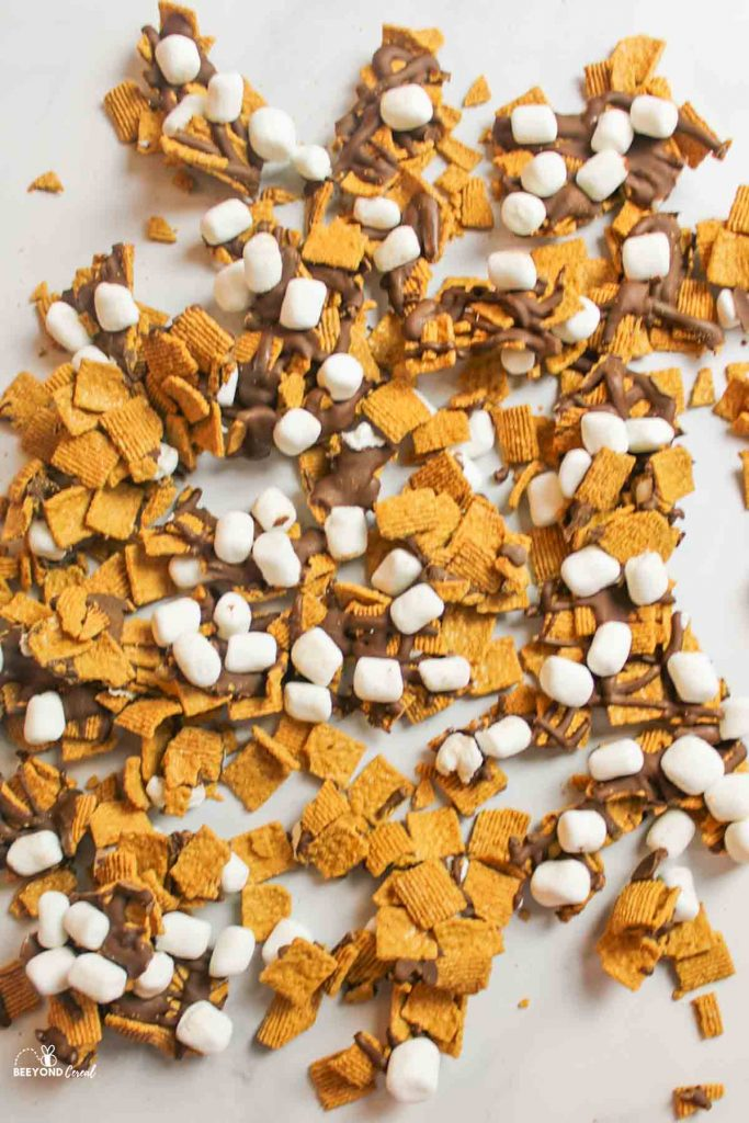 a large scattered assortment of golden graham snack mix
