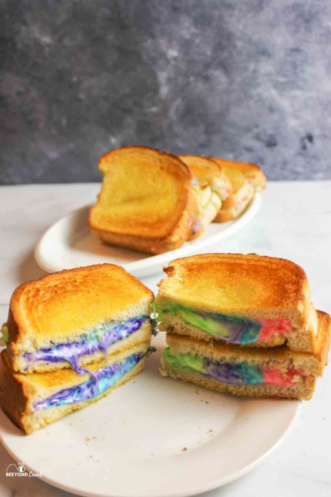 rainbow grilled cheese sandwiches cut on a plate