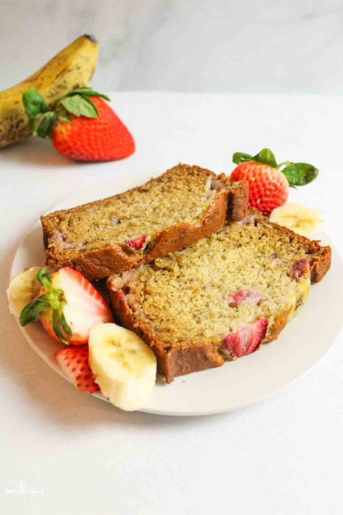 two strawberry banana bread slices on a white plate