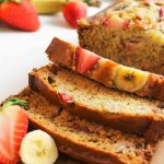 an upclose view of sliced strawberry banana bread