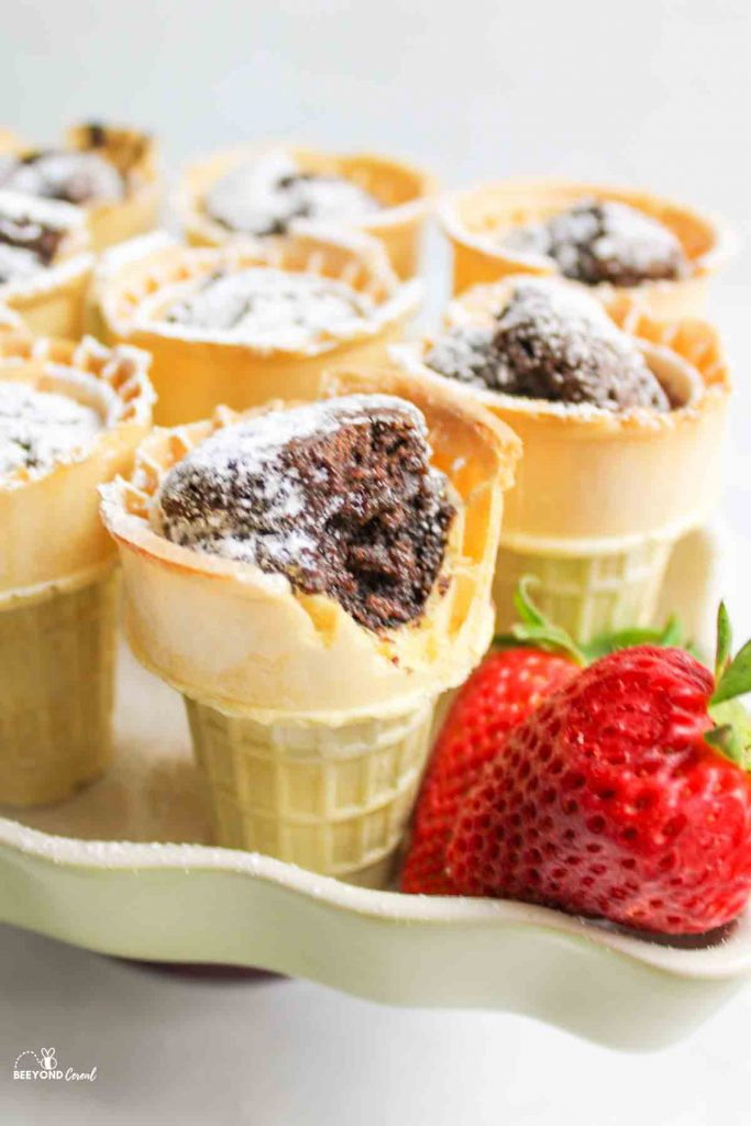 brownie batter filled ice cream cones in a mini muffin pan