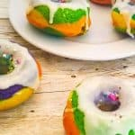 baked rainbowcake donuts with glaze and sprinkles