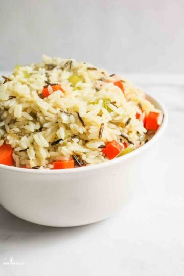 a close side view of a bowl of wild rice pilaf