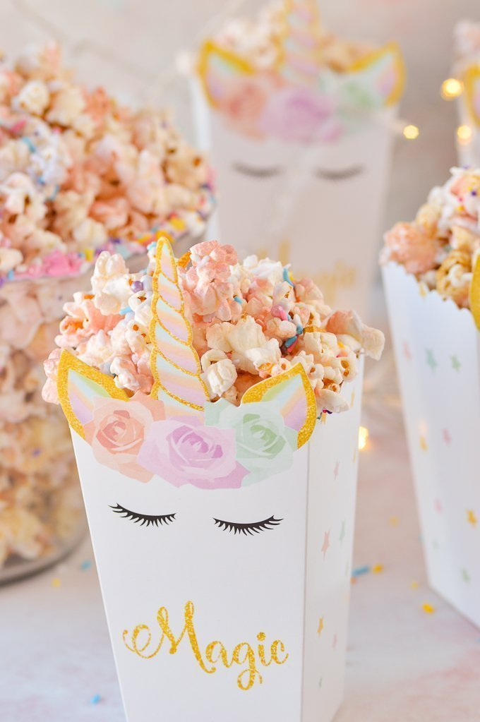unicorn popcorn in a unicorn bo with the word magic written on it
