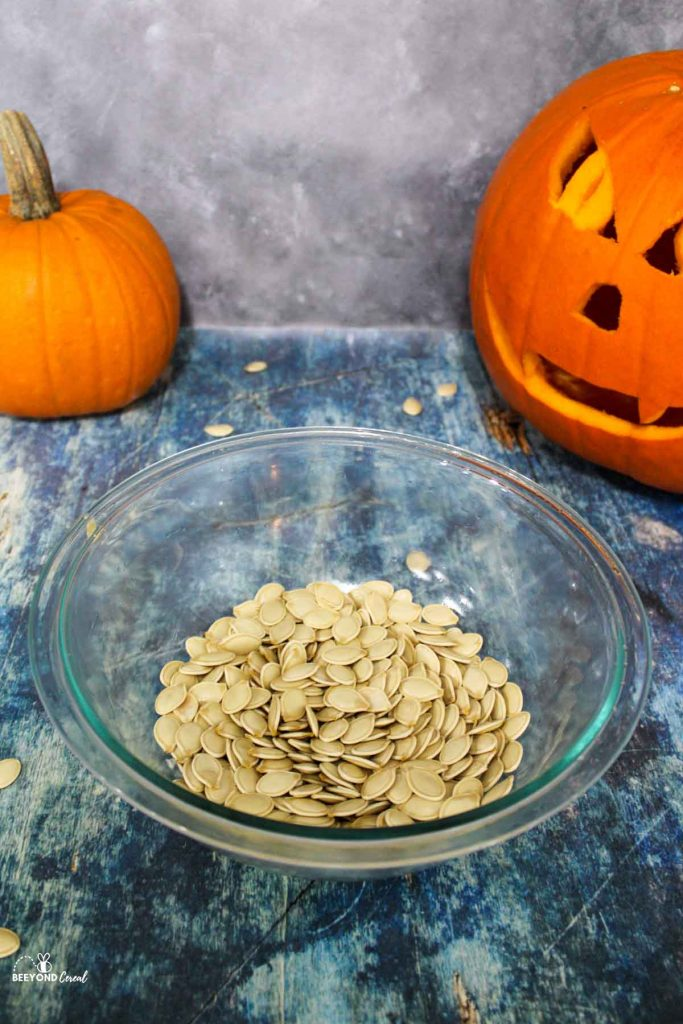 cleaned and dried pumpkin seeds in a glass bowl