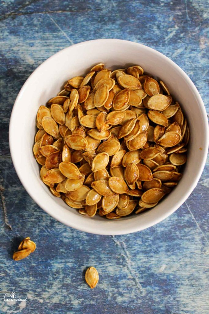 a bowl filled with honey roasted pumpkin seeds