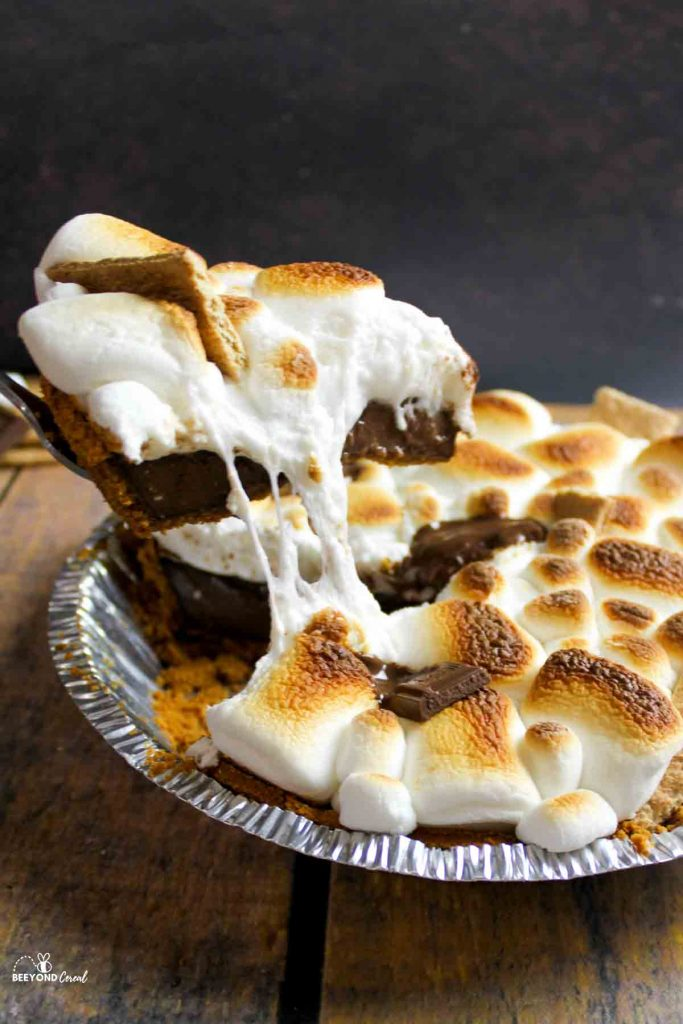 removing a gooey slice of smores pie
