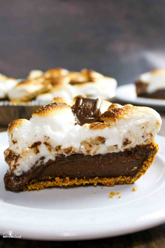 a slice of smores pie on white plate