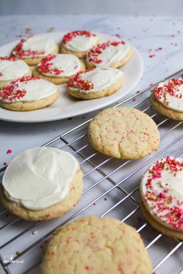 cherry chip cookies some with frosting and sprinkles and some without