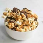chocolate peanut butter popcorn in a white bowl