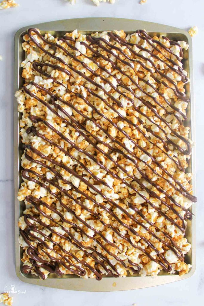 chocolate drizzled on peanut butter popcorn