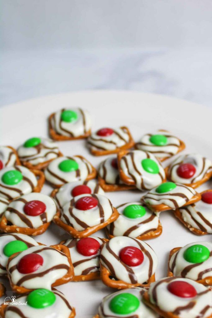 up close view of red and green M&M topped christmas pretzels