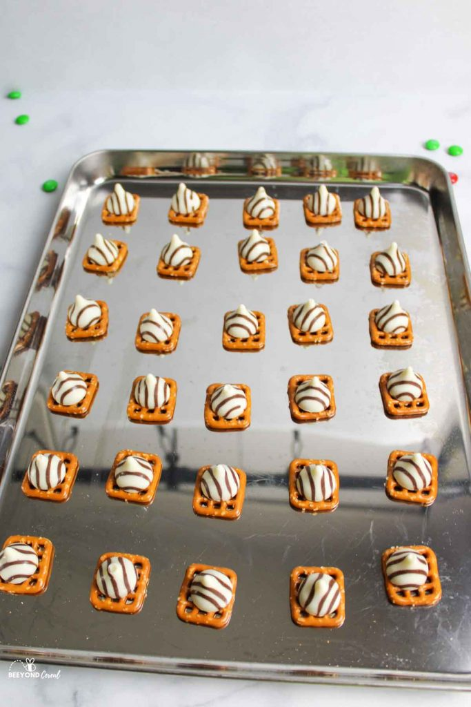 baking sheet with hug topped pretzels on top