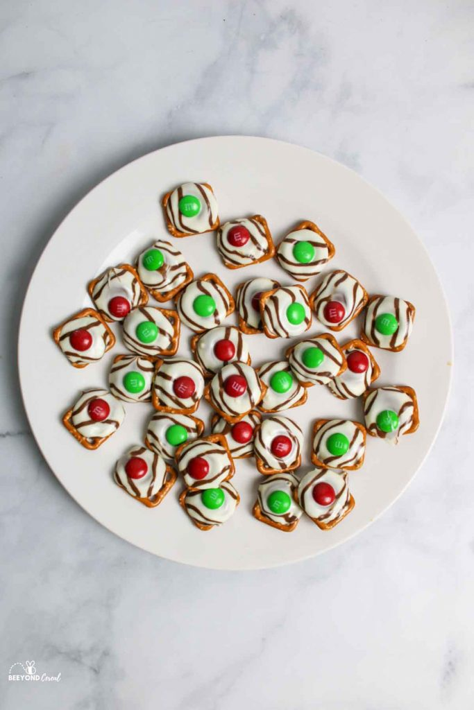 aerial view of christmas pretzels on white plate