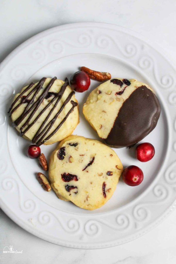 aerial view of cranberry shortbread cookies with whole cranberries and pecans
