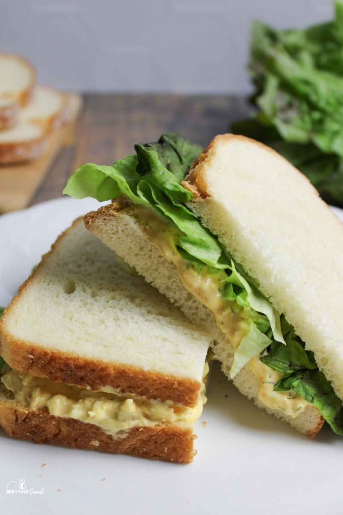 egg salad sandwich halves stacked on a plate