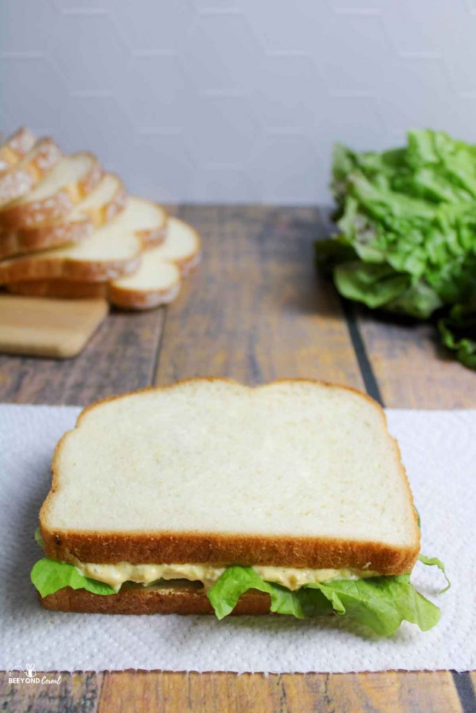 egg salad sandwich with lettuce on paper towel