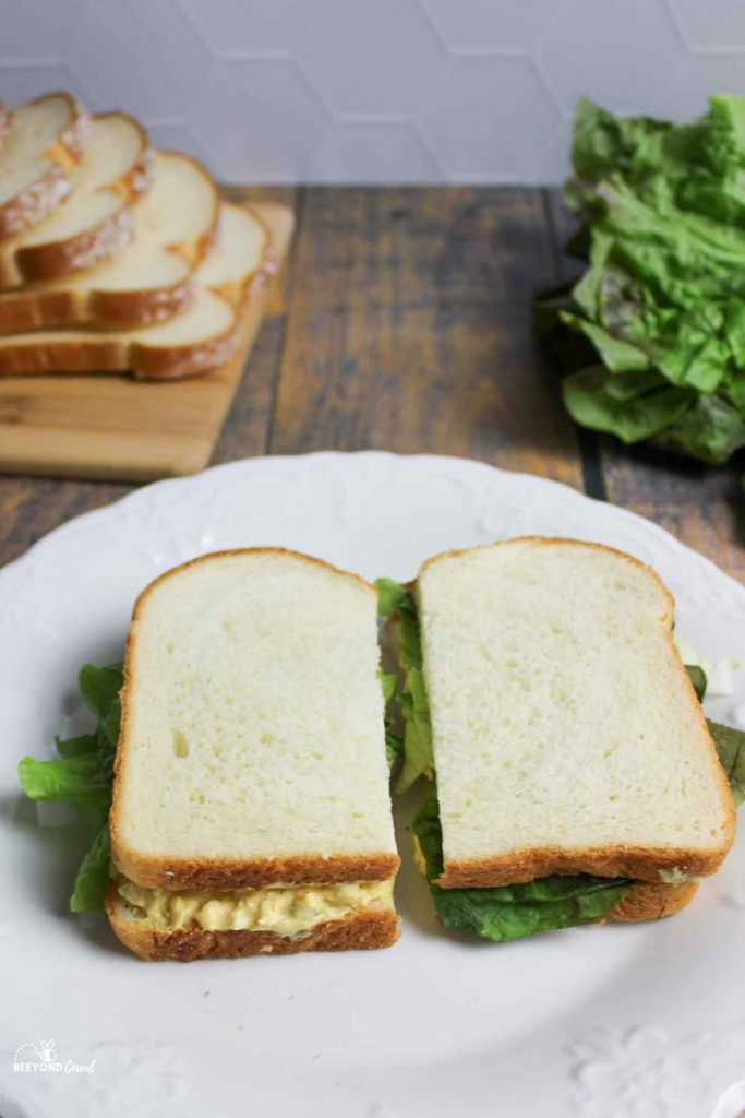 two halves of an egg salad sandwich