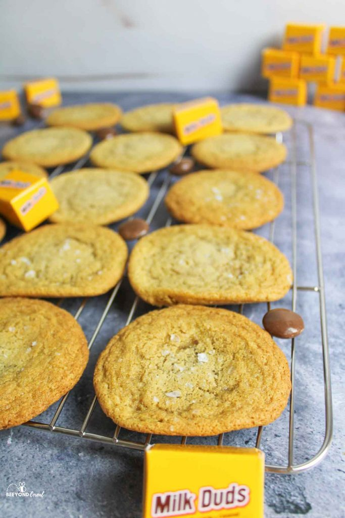 milk dud stuffed cookies on a wire cooling rack