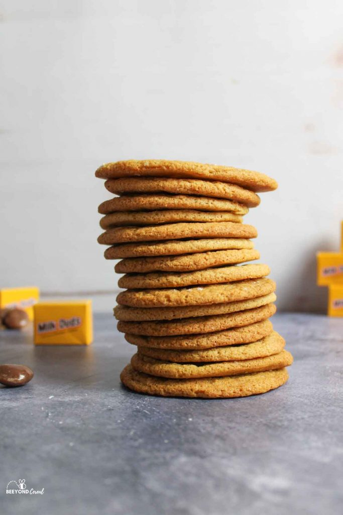 a stack of thin milk dud stuffed cookies