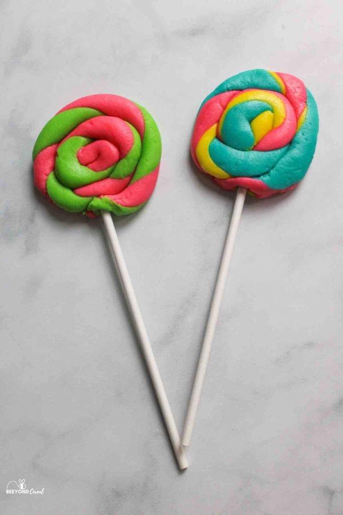 two raw lollipop shaped playdoh cookies