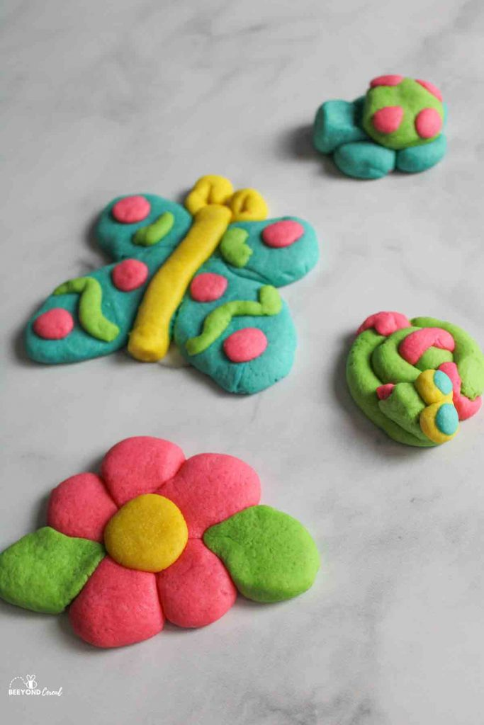 acookie shaped like a butterfly, flower, turtle, and snake