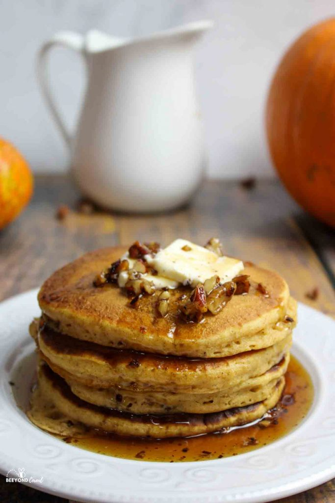 butter pecan syrup on a stack of pumpkin pancakes