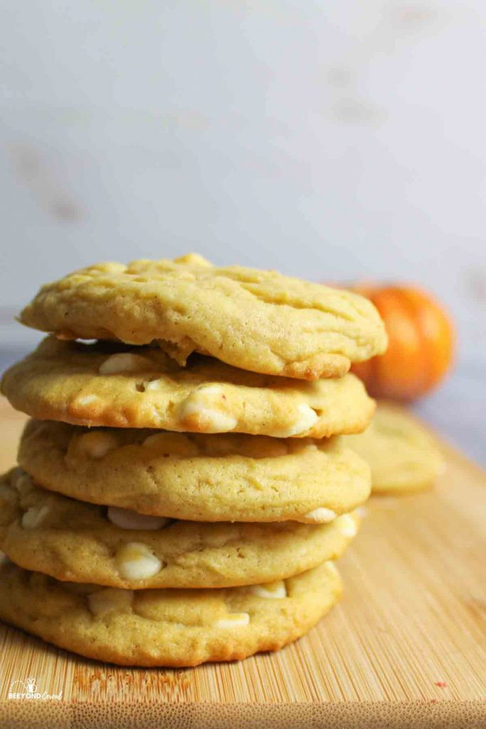 a stack of pumpkin white choc chip cookies
