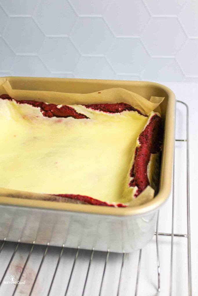 red velvet cheesecake brownie baked in parchment lined dish