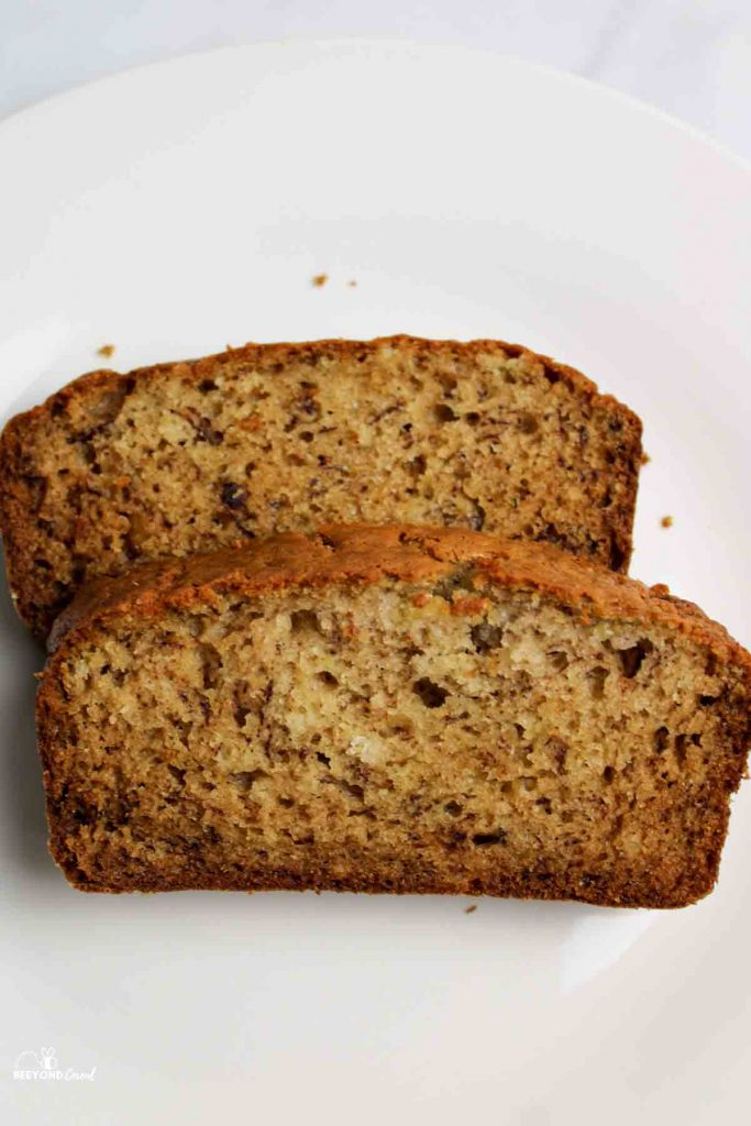 two slices of banana bread on a white plate
