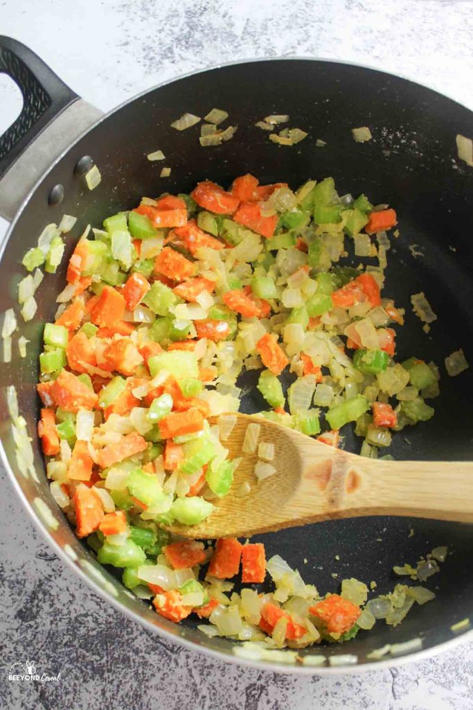 a pot of celery carrots and onions stirred with flour
