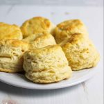 biscuits crowded on a white plate