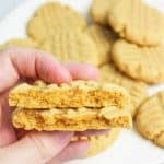hand holding up halves of a cake mix peanut butter cookies to reveal inside