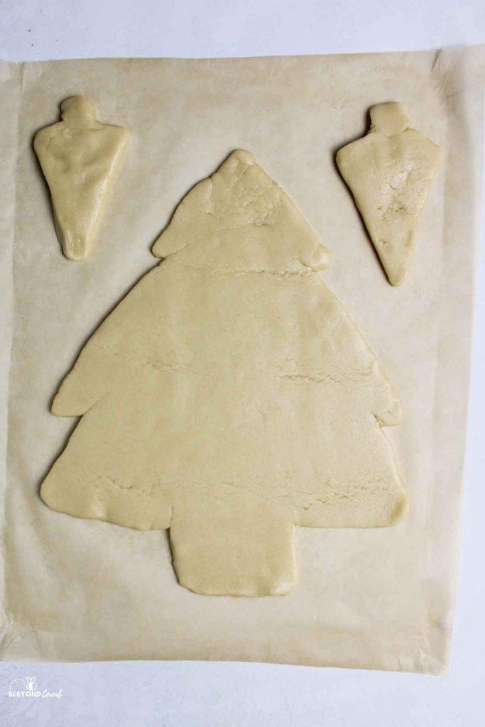 raw sugar cookie dough shaped like christmas trees