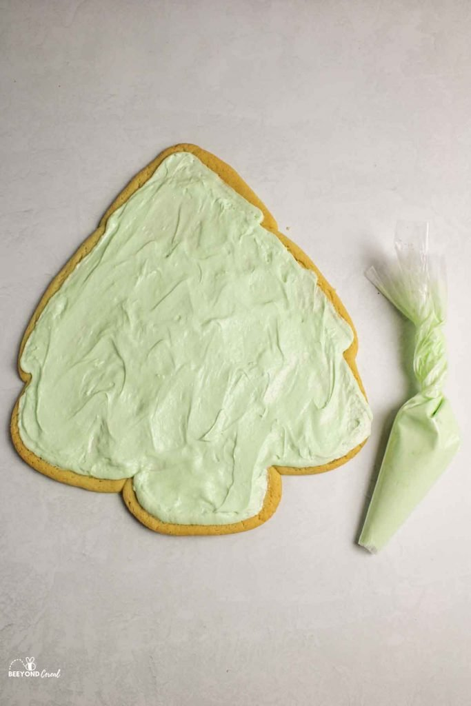 piped frosting on christmas tree cookie