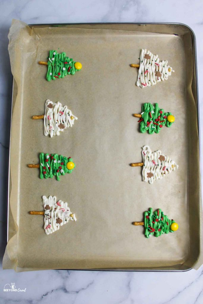 decorated white chocolate trees with pretzels sticks