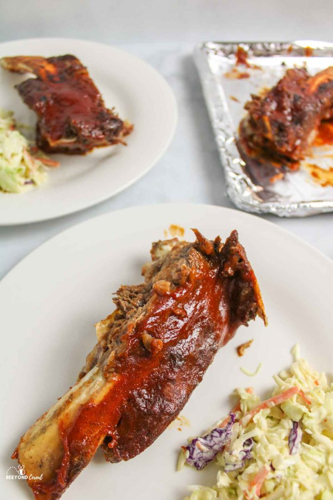 bbq beef ribs and coleslaw on plates