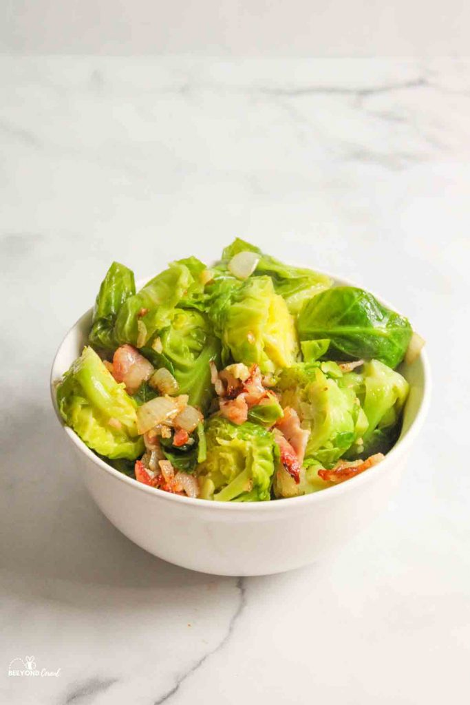 instant pot brusssel sprouts and bacon in a white bowl