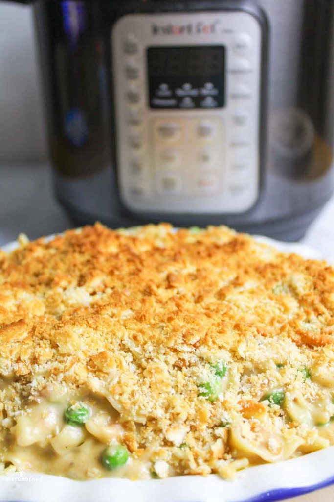 instant pot behind a tuna casserole with ritz topping