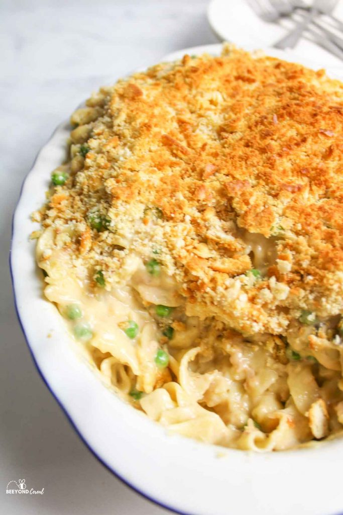 casserole dish full of tuna noodle casserole with some missing