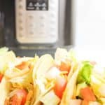 upclose view of turkey tacos with blurred instant pot in background