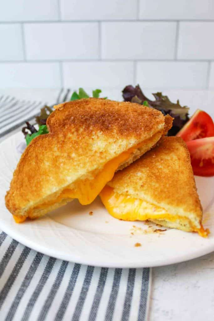 microwaved grilled cheese sandiwch with melty cheese coming out the sides