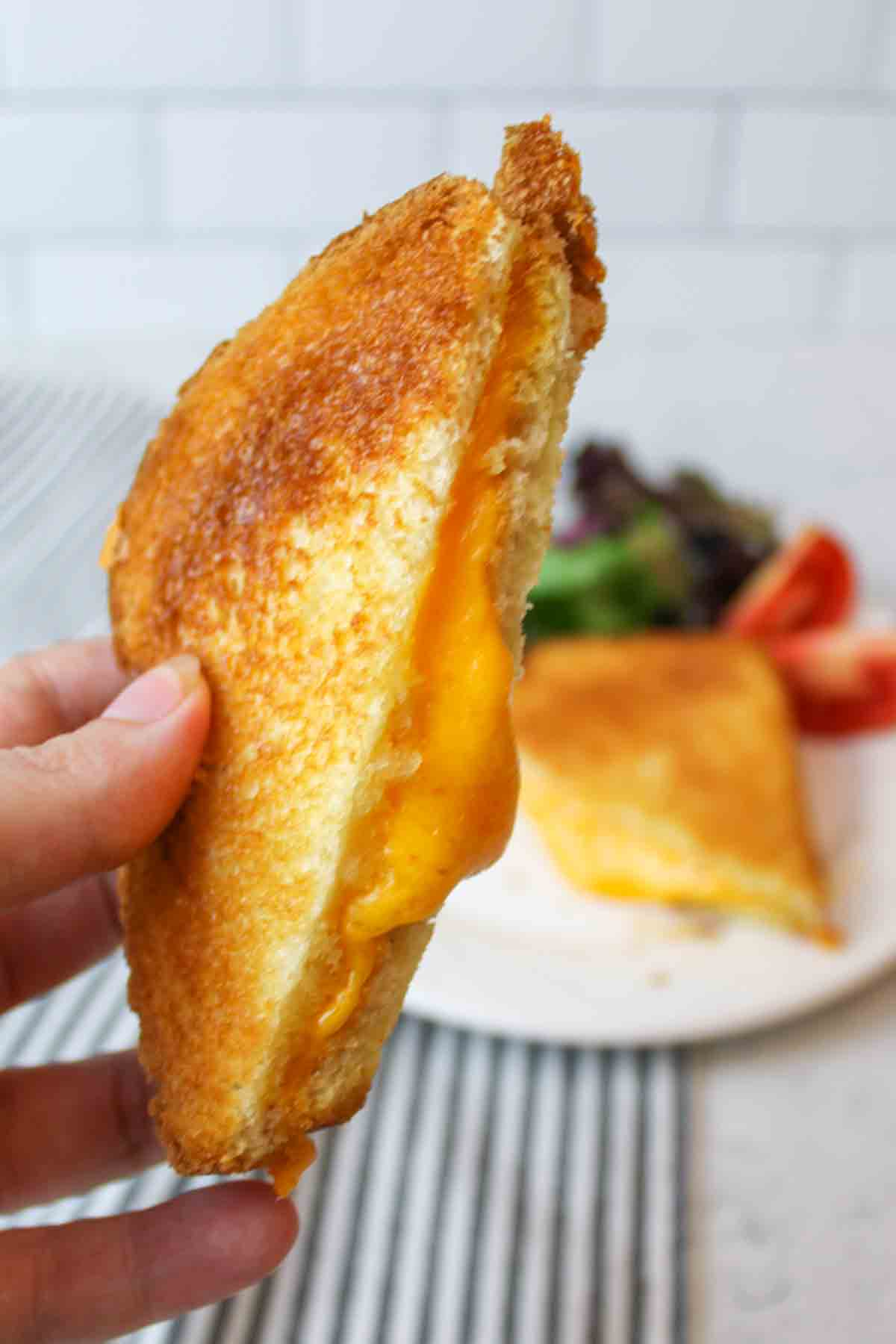 gooey melted cheese coming out of a microwave grilled cheese