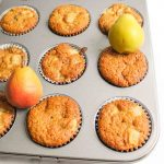 pear muffins baked in baking tray with fresh pears