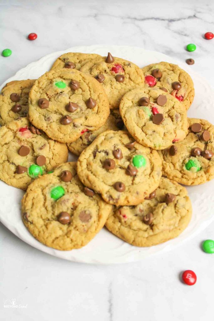 plate full of chocolate chip m&m cookies