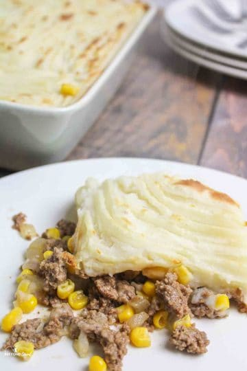 an upclose view of a serving of shepherds pie on a plate
