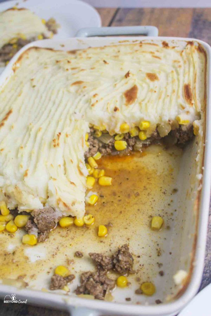 a baking dish of shepherds pie with servings removed